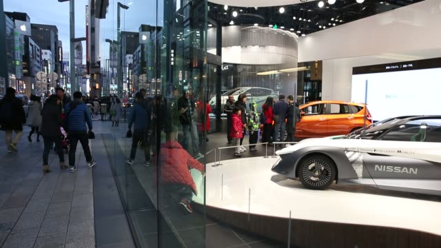 The Nissan Concept 2020 Vision Gran Turismo concept vehicle sits displayed seen from an escalator at Nissan Motor Co's Nissan Crossing showroom in...