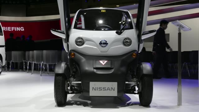 The Nissan Motor Co New Mobility CONCEPT electric vehicle is displayed at the 43rd Tokyo Motor Show 2013 in Tokyo Japan on Wednesday Nov 20 General...