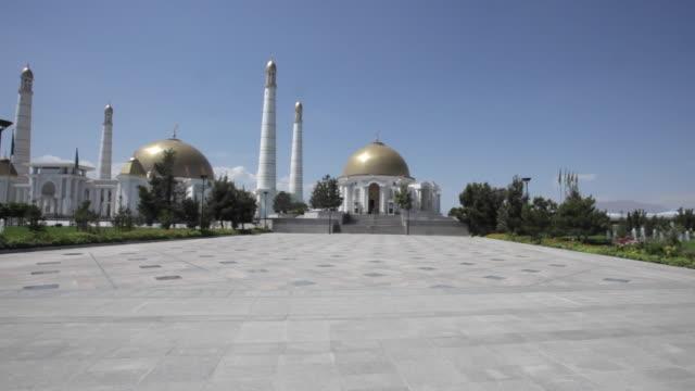 The Niyazov mausoleum next to the Turkmenbashi Ruhy Mosque or Gypjak Mosque, Ashgabat, Turkmenistan