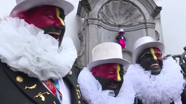 the noirauds or blackies a group that marks belgium's annual carnival season by charitable fund raising in black face paint have changed their colours - belgium stock videos & royalty-free footage