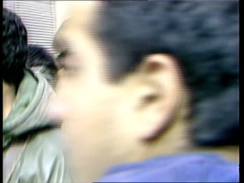 stockvideo's en b-roll-footage met gaza strip ms armed israeli soldiers towards and rl along street cms soldiers towards one with arm around captive palestinian's face rl ms soldier... - israëlisch palestijns conflict