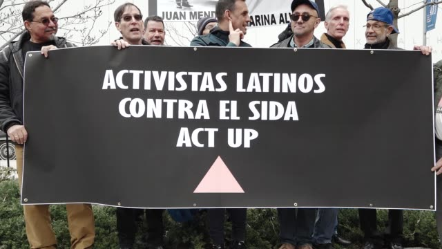 the non-partisan group act up commemorates its 30th anniversary of fighting aids – hiv / the group gathered at the aids memorial on the west village... - レトロウィルス点の映像素材/bロール