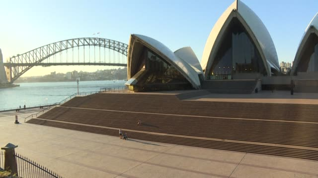 the normally bustling sydney opera house steps as virus restrictions in australia close the iconic venue and impose tight restrictions on movement,... - opera house stock videos & royalty-free footage