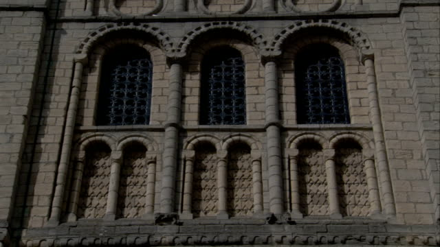 the norman tower in bury st edmunds features rows of arched windows. available in hd. - bury st edmunds stock videos & royalty-free footage