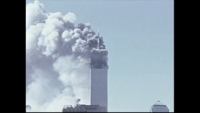 stockvideo's en b-roll-footage met the north tower collapses after the attacks on september 11th/ - aanslagen op 11 september 2001