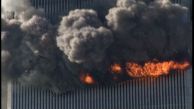 the north tower of the world trade center burning and smoking, then collapsing in a huge cloud of dust; people can be heard screaming and yelling. - terrorismus stock-videos und b-roll-filmmaterial