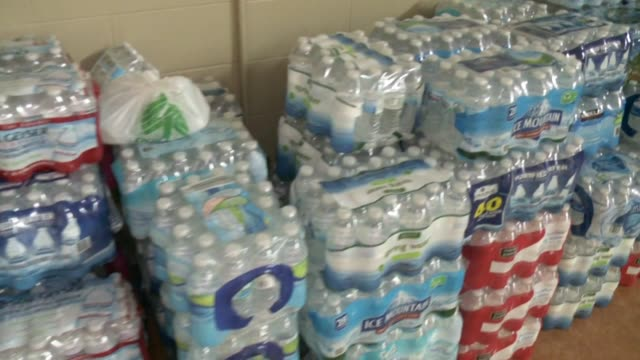 the northside ministerial alliance and the city of kalamazoo, michigan collected water bottles at mt. zion baptist church to send to citizens of... - crisis stock videos & royalty-free footage