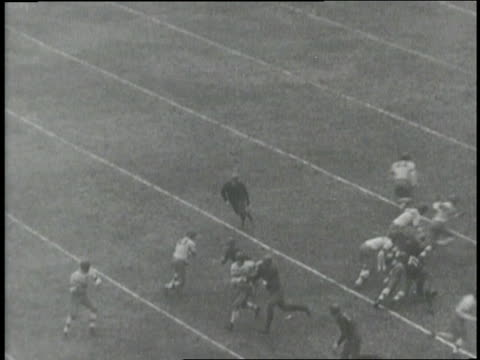 vídeos de stock e filmes b-roll de the notre dame fighting irish play the stanford indians in the 1925 rose bowl. - 1925