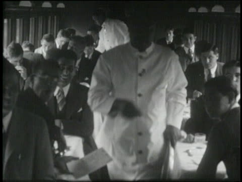 the notre dame football team eats a meal in the dining car of train - 1924年点の映像素材/bロール