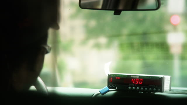 the numbers of a taxi's fare box change rapidly. - taxi driver stock videos and b-roll footage