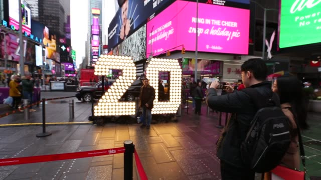 the numerals '20' are lit up in times square ahead of the new year's eve celebration on december 20 in new york, united states. the '19' numerals... - 2019 stock videos & royalty-free footage