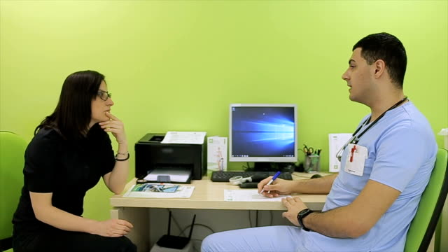 the nutritionist gives nutrition advice to patient - nutritionist stock videos and b-roll footage