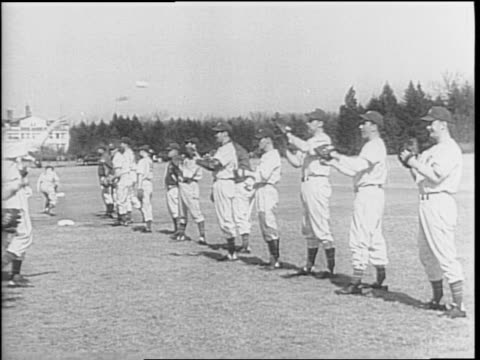 the ny giants team trains on field / managers melvin ott and carl hubell talk / man runs bases at st louis browns training ground / pete cray... - baseballmannschaft stock-videos und b-roll-filmmaterial