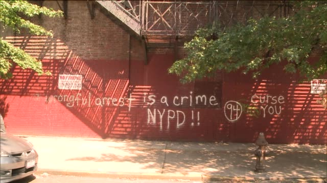 the nypd's hate crime task force is investigating antipolice graffiti on wall outside of 94th precinct in greenpoint brooklyn vandals spraypainted... - greenpoint brooklyn stock videos & royalty-free footage