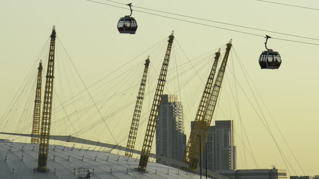 the o2 and passing cable cars crossing the thames - the o2 england stock videos & royalty-free footage