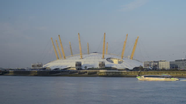the o2 on the thames with river bus passing  - the o2 england stock videos & royalty-free footage