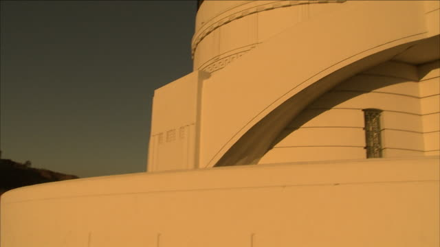the observation dome of griffith observatory in los angeles at sunset. - griffith observatory stock videos & royalty-free footage