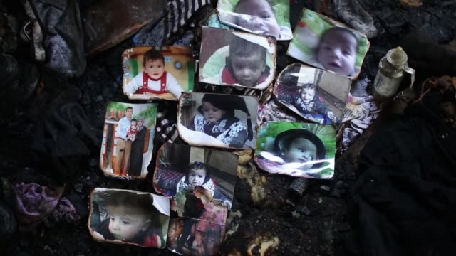 The occupied West Bank mark on Sunday the first anniversary of a firebombing by Jewish extremists that killed an 18 month old Palestinian boy and his...