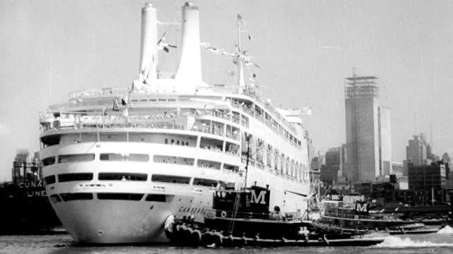 The ocean liner Canberra arrives in New York harbor / tugboats and fire boat salute / this is the first load of JFK's program to bring tourists to...