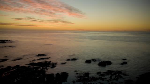the ocean washes onto the rocky shore of kaikoura peninsula, south island, new zealand. - kaikoura stock videos & royalty-free footage