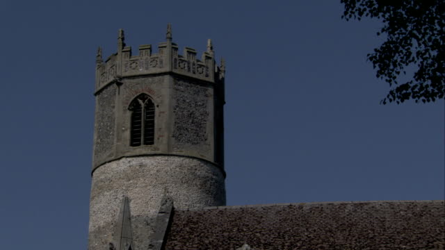 the octagonal belfry of st. mary's church in rickinghall inferior stands out against a bold blue sky. available in hd. - octagon stock videos & royalty-free footage