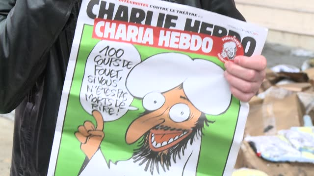 the offices of a french satirical newspaper that published a special arab spring edition with the prophet mohammed as guest editor are destroyed in a... - satire stock videos & royalty-free footage