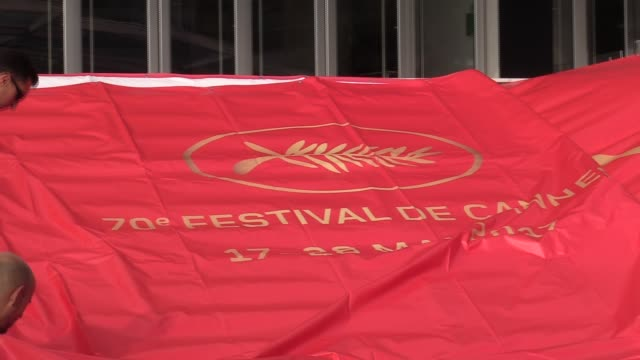 the official cannes film festival poster is unveiled at the 70th cannes film festival on may 15 2017 in cannes france - festival poster stock videos & royalty-free footage