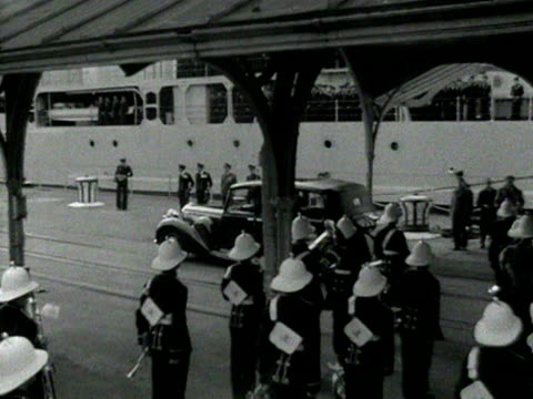 the official cars carrying emperor haile selassie and his entourage leave portsmouth docks at the start of his state visit to britain 14 october 1954 - state visit stock videos & royalty-free footage