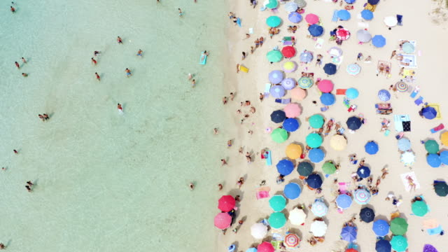 the official hotspot for holiday makers - beach umbrella stock videos & royalty-free footage