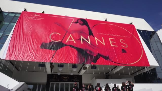 the official poster of the 70th cannes film festival was unveiled on monday on the facade of the venue - festival poster stock videos & royalty-free footage