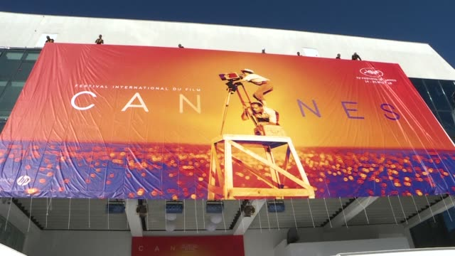 the official poster of the 72nd cannes film festival is unveiled on the facade of the palais des festivals - poster stock videos & royalty-free footage