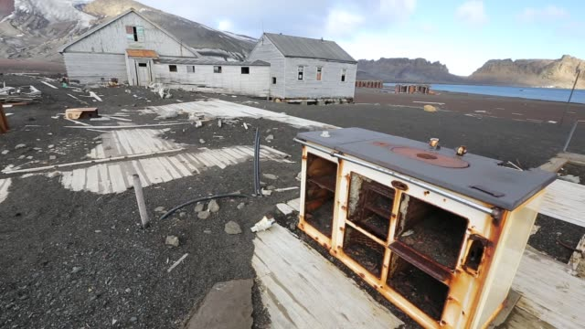 the old british antarctic survey station on deception island in the south shetland islands off the antarctic peninsular which is an active volcanic caldera. it was abandoned in 1967 when it was over run by a volcanic eruption. - 1967 stock videos & royalty-free footage
