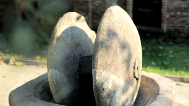 the old cold press stones of traditional olive oil extracting - millstone stock videos & royalty-free footage