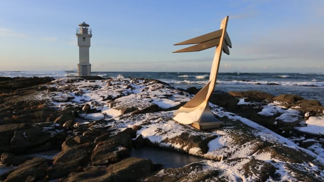 the old lighthouse and the mermaid sculpture, akranes town, south west iceland - lighthouse stock videos & royalty-free footage
