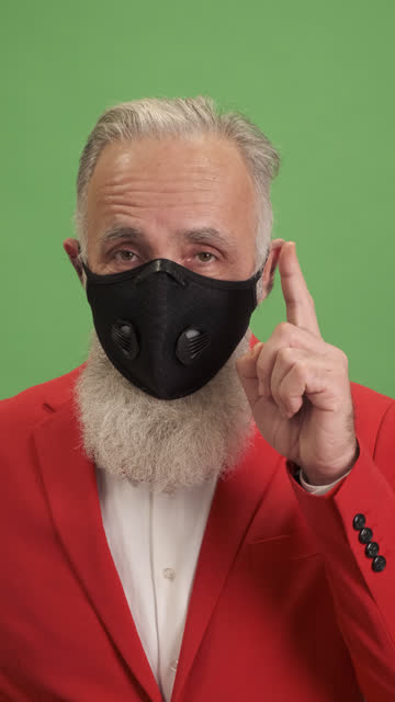 the old man points to his protective mask indicating the need to wear it.close-up - shirt and tie stock videos & royalty-free footage