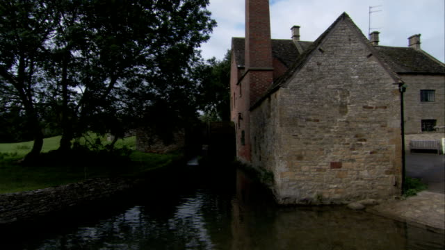 the old mill museum operates a watermill in lower slaughter, england available in hd. - water wheel stock videos and b-roll footage