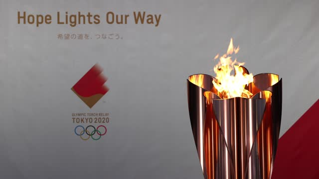 the olympic cauldron seen lit at hibarigahara field during the tokyo olympic games torch relay on march 25, 2021 in minamisoma, fukushima, japan. - igniting stock videos & royalty-free footage