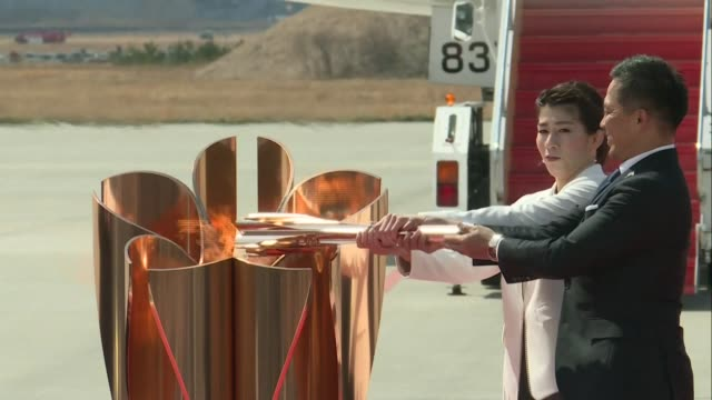 the olympic flame arrives in japan to a muted reception with what should have been a joyous celebration dramatically downscaled due to the... - lighting equipment stock videos & royalty-free footage