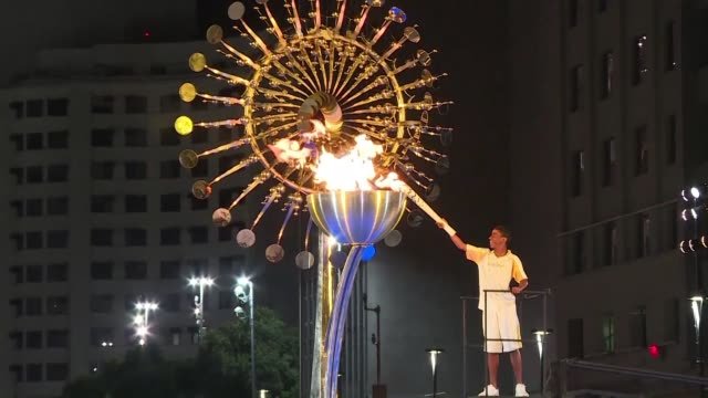 the olympic flame burns in rios city center after being carried from maracana stadium where the opening ceremony took place - olympic torch stock videos & royalty-free footage