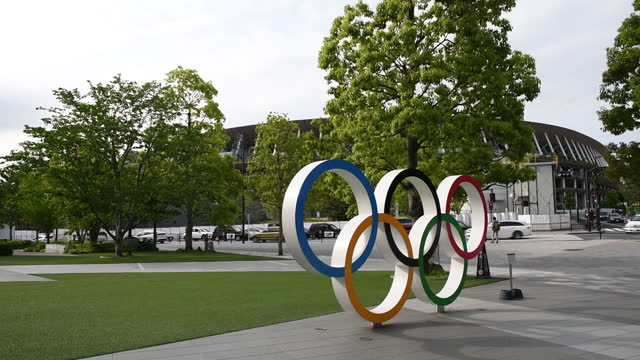 the olympic rings outside the national stadium, the main venue for the tokyo 2020 olympic and paralympic games, in tokyo, japan, on tuesday, may 11,... - sport venue stock videos & royalty-free footage