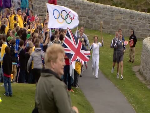 the olympic torch is carried through the shetlands. - flaming torch stock videos & royalty-free footage