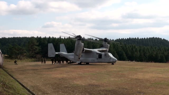 the ongoing joint exercise between the japan ground selfdefense forces and the us marine corps called forest light 151 is using an mv22 osprey... - japan self defense forces stock videos and b-roll footage