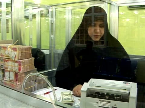 the only men are the ones standing guard outside: welcome to the first bank reserved exclusively for women. in the holy town of najaf, one... - najaf stock videos & royalty-free footage