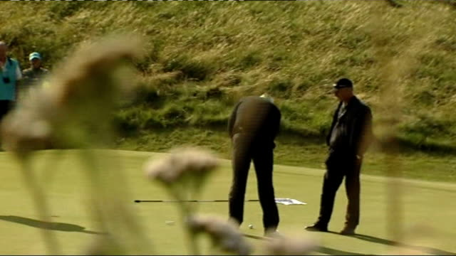 Montgomerie practicing ENGLAND Lancashire Southport Royal Birkdale EXT Golfer Colin Montgomerie with caddy and coach on green practicing putting /...