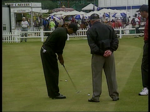 practice day itn scotland st andrews tiger woods practicing putting c5l - tiger woods stock videos & royalty-free footage
