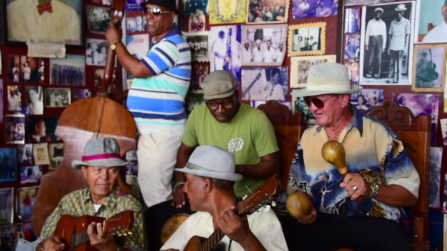 the open doors place offers traditional cuban music to visitors the musicians accept tips from tourists the place preserves part of the history of... - santiago de cuba stock videos and b-roll footage