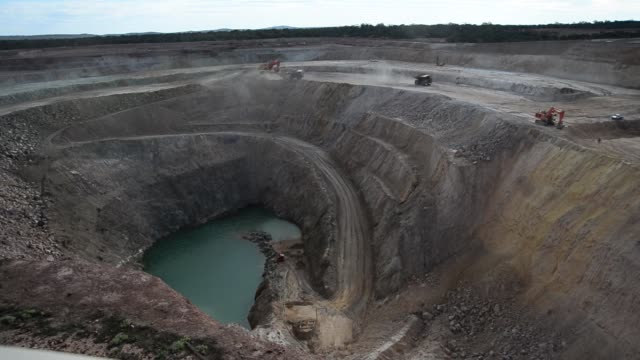 the open mine pit sits at the norton gold fields ltd enterprise operations 68 kilometers north west of kalgoorlie australia on wednesday aug 7 dump... - 掘る点の映像素材/bロール