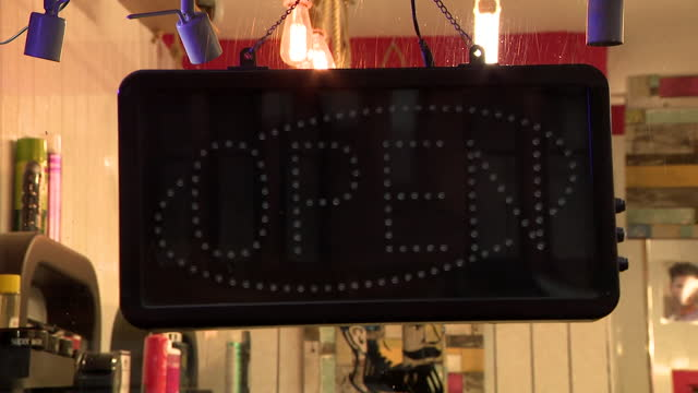 the 'open' sign in a shop being switched off - less than 10 seconds stock videos & royalty-free footage