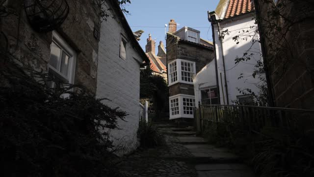 the opening and narrow alley, robin hood's bay, north yorkshire, england, united kingdom, europe - narrow stock videos & royalty-free footage