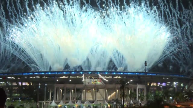 the opening ceremony of the 2016 rio olympics is marked by multiple impressive displays of fireworks over maracana stadium - opening ceremony stock videos & royalty-free footage